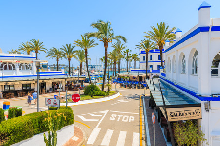 ESTEPONA PORT, SPAIN - MAY 9, 2018: Restaurants and shops in popular tourist town on Costa del Sol coast in southern Spain on sunny summer day. Editorial