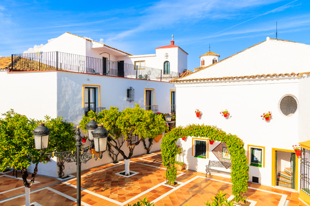 Square with typical white houses in small village near Marbella. Andalusia, Spain