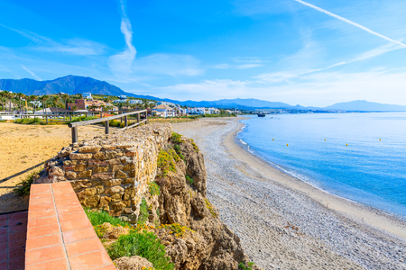 View of beach and coastal path near Estepona town on Costa del Sol, Spain Stock Photo