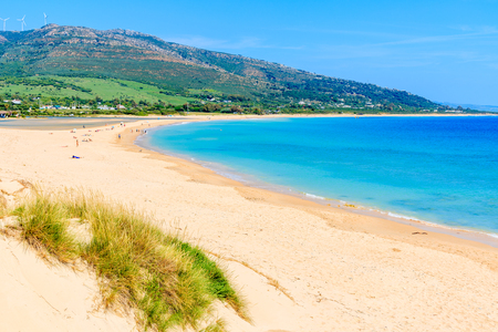 Sandy Paloma beach and view of sea bay, Andalusia, Spain