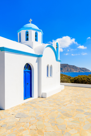 White chapel on sea coast in Ammopi village, Karpathos island, Greece