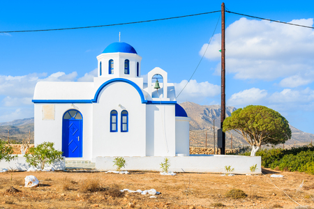 Traditional white church in rural landscape of Karpathos island, Greece