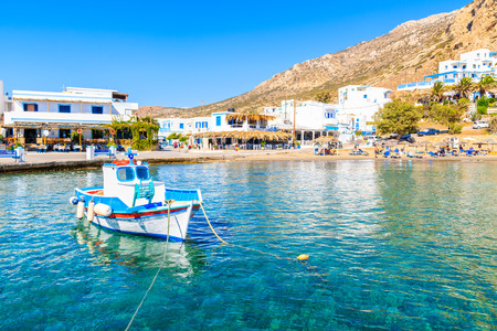 Fishing boat on turquoise sea water in Finiki port, Karpathos island, Greece