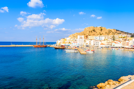 Fishing boats in Pigadia port on Karpathos island at sunset time, Greece Stock Photo