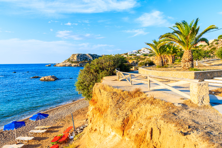 View of beautiful beach and coastal promenade in Ammopi village at sunrise on Karpathos island, Greece