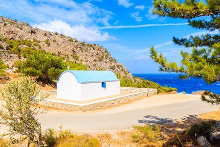 White church along road to beautiful Achata beach, Karpathos island, Greece