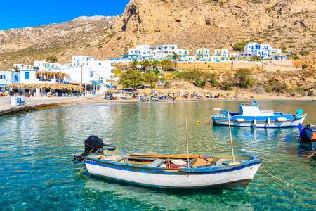 Fishing boats on turquoise sea water in Finiki port, Karpathos island, Greece
