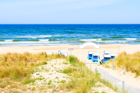 Path to beach among sand dunes in Baabe coastal village, Baltic Sea, Germany