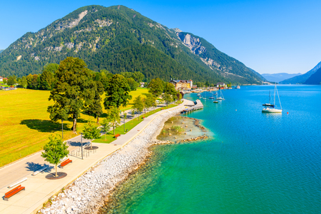 View of beautiful Achensee lake and boats on sunny summer day with blue sky, Karwendel mountain range, Tyrol, Austria Imagens