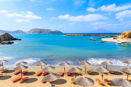Umbrellas and sunbeds on beautiful Finiki beach, Karpathos island, Greece 写真素材