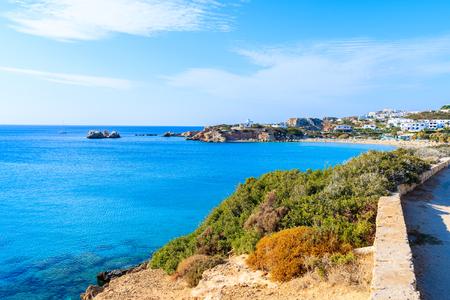 Coastal walkway along azure sea in beautiful bay on Karpathos island in Ammopi village, Greece