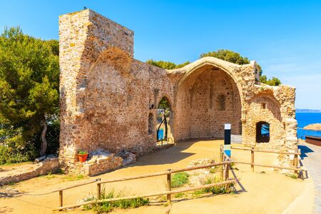 Ruins of old church in Tossa de Mar town on castle hill, Costa Brava, Spain
