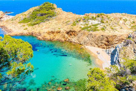 Boats in beautiful sea bay with beach near Sa Tuna village, Costa Brava, Spain