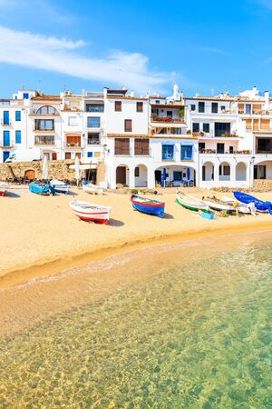 Traditional fishing boats on beach in Calella de Palafrugell, scenic village with white houses and sandy beach with clear blue water, Costa Brava, Catalonia, Spain 写真素材