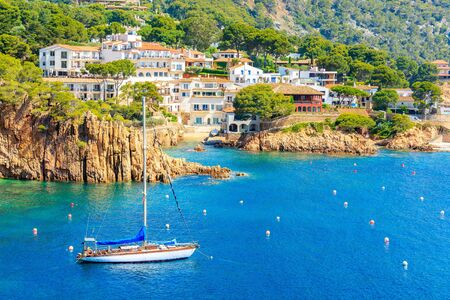 Sailing boats on sea in picturesque bay near Fornells village, Costa Brava, Spain 写真素材