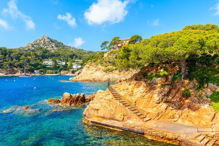 View of coastal path and sea in picturesque port of Fornells village, Costa Brava, Spain
