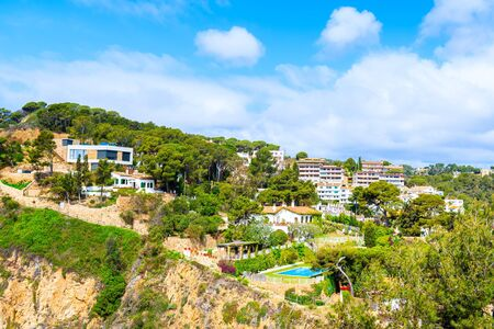 Villas on high cliff near sea in Tossa de Mar town, Costa Brava, Spain