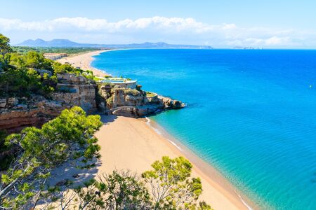 View of stunning beach of Cala Moreta with azure blue sea water, Costa Brava, Spain