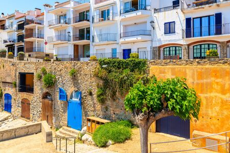 Houses in Calella de Palafrugell, scenic fishing village with white houses and sandy beach with clear blue water, Costa Brava, Catalonia, Spain 写真素材