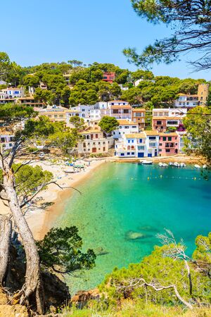 View of colorful houses in sea bay with beach in Sa Tuna coastal village, Costa Brava, Spain 写真素材