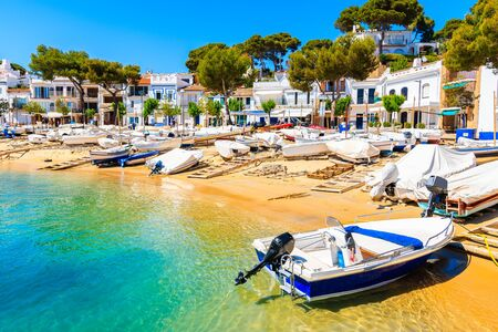 Traditional colorful fishing boats on beach in Llafranc port, Costa Brava, Spain