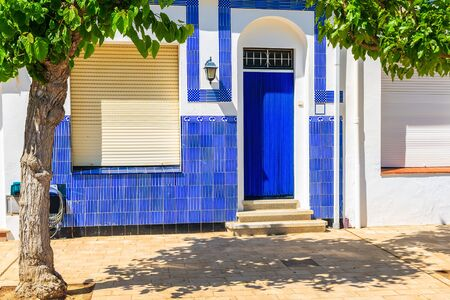 Blue door of a typical house in Llafranc town, Costa Brava, Spain