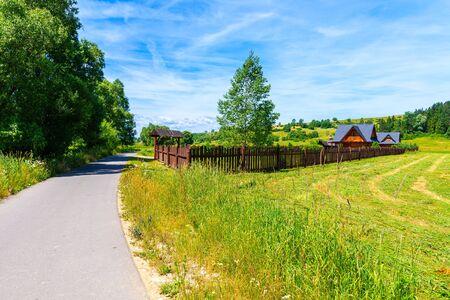 Cycling way along green fields near Czorsztynskie lake and Nowy Targ, Tatra Mountains, Poland Reklamní fotografie