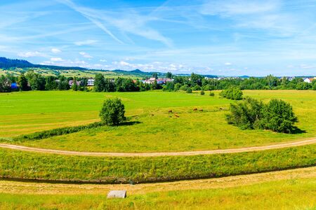 Green countryside landscape in Frydman village in Pieniny Mountains near Czorsztynskie lake on sunny summer day, Poland Reklamní fotografie
