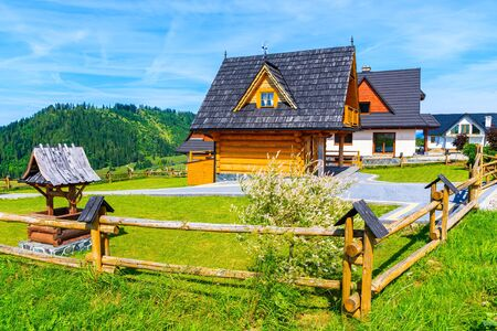 Wooden typical mountain house on green meadow in Tatra Mountains on sunny summer day, Poland Reklamní fotografie