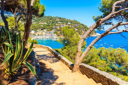 Coastal path to Llafranc town and view of sea bay with boats, Costa Brava, Spain