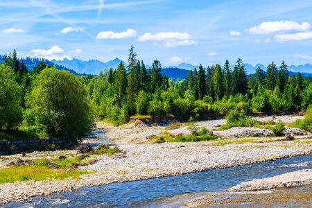Dunajec river with green hills on shore on sunny summer day near Nowy Targ, Tatra Mountains, Poland Reklamní fotografie