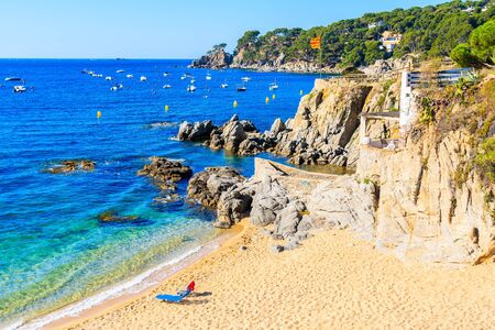 Chairs on beach in Calella de Palafrugell fishing village, Costa Brava, Spain Reklamní fotografie