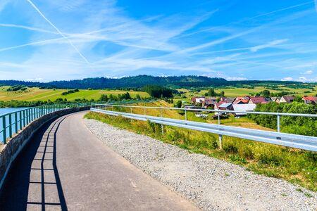 Cycling way along Czorsztynskie lake in Frydman village, Pieniny Mountains, Poland