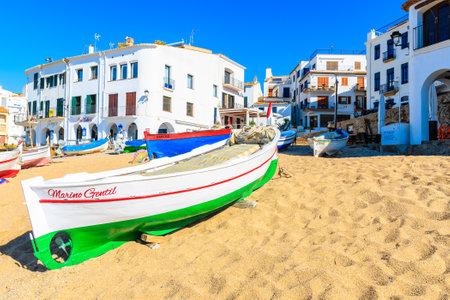 CALELLA DE PALAFRUGELL, SPAIN - JUN 2, 2019: Traditional colorful fishing boats on beach in Port Bo, Costa Brava, Spain.