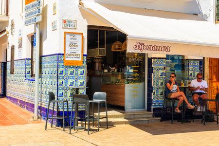 LLAFRANC TOWN, SPAIN - JUN 1, 2019: People sitting under shade in front of typical restaurant in Llafranc town, Costa Brava, Spain. Redakční