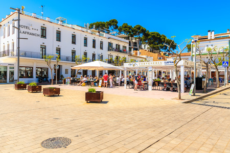 LLAFRANC TOWN, SPAIN - JUN 1, 2019: Square with restaurants and white houses  in Llarfanc town, Costa Brava, Spain.