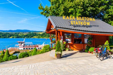 PIENINY MOUNTAINS, POLAND - JUN 29, 2019: Kiosk selling tickets for boat cruise around Czorsztynskie lake on beautiful summer day in Niedzica village, Pieniny Mountains, Poland.