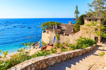 Walkway to beach near castle in Calella de Palafrugell fishing village, Costa Brava, Catalonia, Spain
