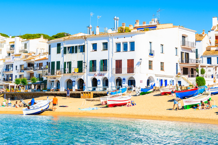 CALELLA DE PALAFRUGELL, SPAIN - JUN 2, 2019: Colorful fishing boats on picturesque beach in Calella de Palafrugell village, Costa Brava, Catalonia, Spain. Redakční
