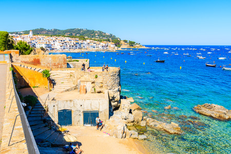 CALELLA DE PALAFRUGELL, SPAIN - JUN 1, 2019: View of tower and beach in beautiful scenic village of Calella de Palafrugell, Costa Brava, Spain. Redakční