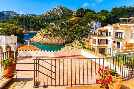 Terrace with flowerpots in Cala Fornells fishing village, Costa Brava, Catalonia, Spain