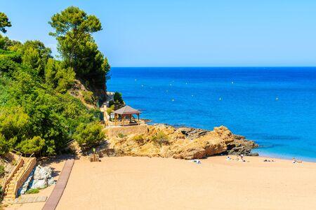 Rocks on stunning beach with azure sea water in beautiful Sa Riera village, Costa Brava, Catalonia, Spain