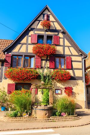 Old typical French house in Beblenheim village on Alsatian Wine Route, France