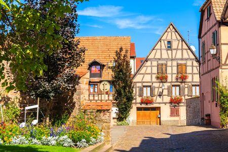 Old colorful houses in Kientzheim village on Alsatian Wine Route, France