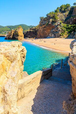 Path to Cala Moreta beach and view of blue sea and rocks, Costa Brava, Catalonia, Spain