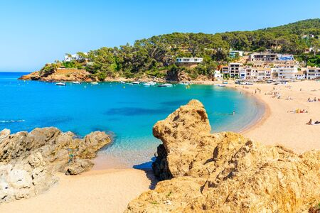 Rocks on stunning beach with azure sea water in beautiful Sa Riera village, Costa Brava, Catalonia, Spain Фото со стока - 130816053