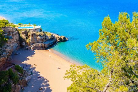 Azure blue sea water at Cala Moreta beach and view of rocks, Costa Brava, Catalonia, Spain Фото со стока - 130816056