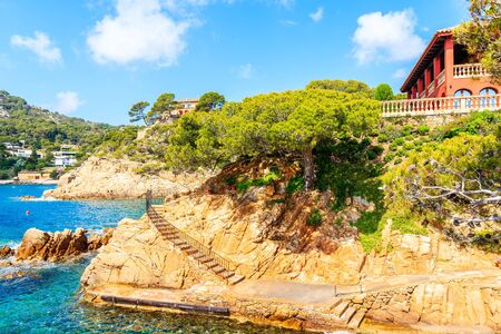 Coastal path in Cala Fornells fishing village, Costa Brava, Catalonia, Spain Фото со стока - 130816058