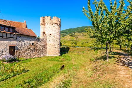Tower of old town walls in Kientzheim village on Alsatian Wine Route, France