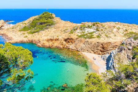 View of beach in Sa Tuna fishing village with boats in sea bay, Costa Brava, Catalonia, Spain Фото со стока - 130816086